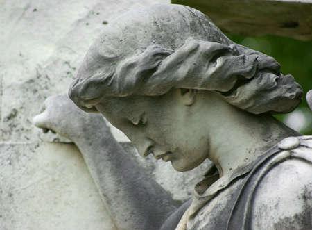 downcast: A statue of a woman with a downcast face.
