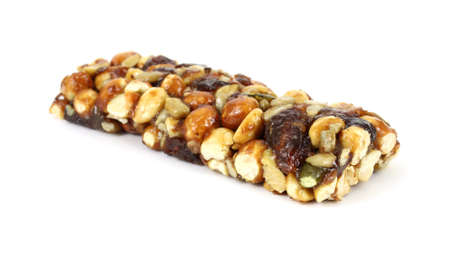 An energy bar with assorted nuts and raisins on a white background.