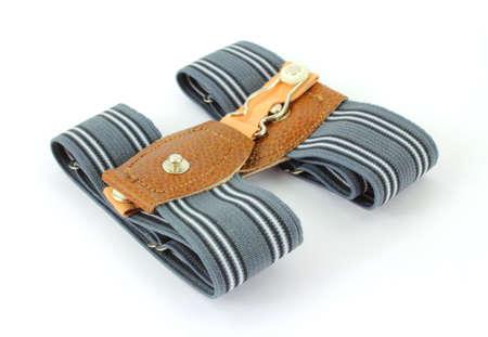 ligueros: Un par de sencillo de agarre ligueros calcet�n para hombres sobre un fondo blanco. Foto de archivo