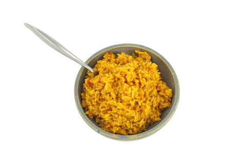 stoneware: Seasoned rice in a stoneware bowl with a fork on a white background. Stock Photo
