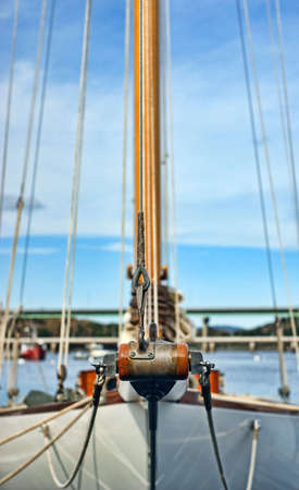 bowsprit: Close view of the very end of a bowsprit of a sailboat.
