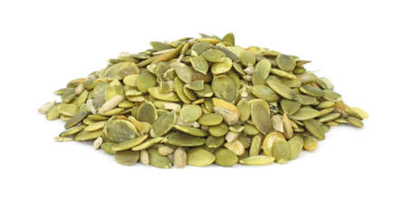 A large amount of raw pumpkin seeds on a white background.