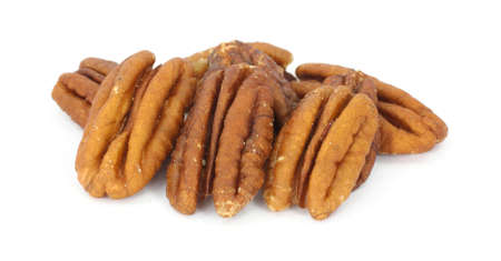 Several pecan nuts on a white background. Imagens