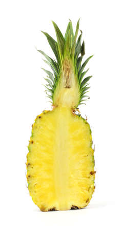 A single pineapple cut in half on a white background. photo