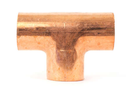 pipe fitting: A copper tee pipe fitting for plumbing on a white background.