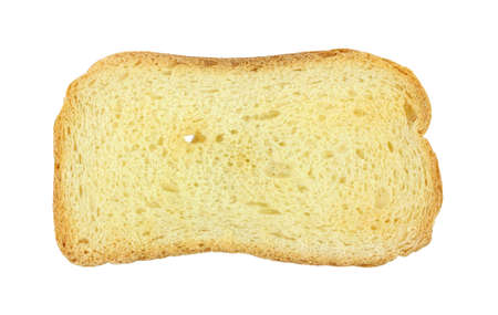 melba: Una sola pieza de melba toast sobre un fondo blanco.
