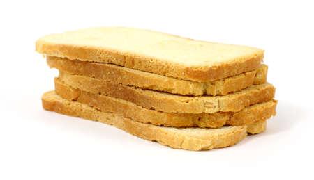melba: Varias piezas de melba brindis en una pila sobre un fondo blanco.