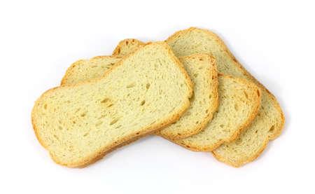 melba: Varias piezas de melba toast sobre un fondo blanco.