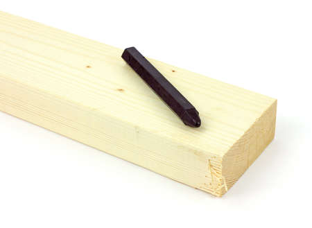 The end of a wood stud with a carpenter's crayon on a wood background. Stock Photo - 8475757