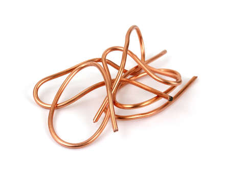 Copper wire for recycling on a white background.