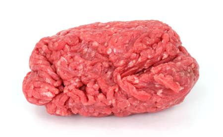 freshly: Lean ground beef freshly ground on a white background.
