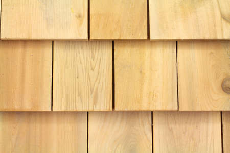 wood surface: Several wood cedar shingles for siding or roofs.
