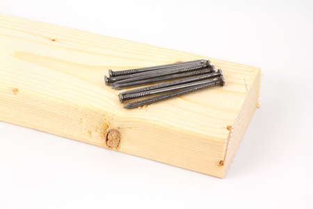 A Wood Stud With Several Large Framing Nails. Stock Photo, Picture ...