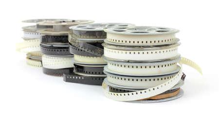 family movies: Varias pilas de viejas pel�culas familiares sobre un fondo blanco. Foto de archivo