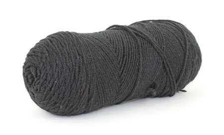 acrylic yarn: A single skein of old black acrylic yarn on a white background. Stock Photo