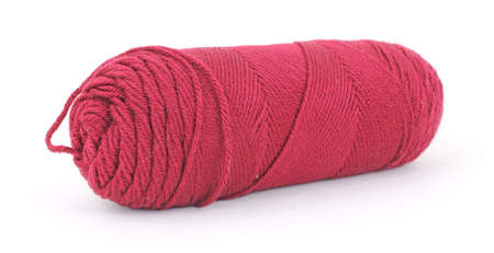 acrylic yarn: A single skein of old red acrylic yarn on a white background.