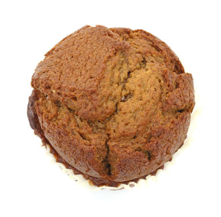 Top view of a delicious ginger bread muffin on a white background.