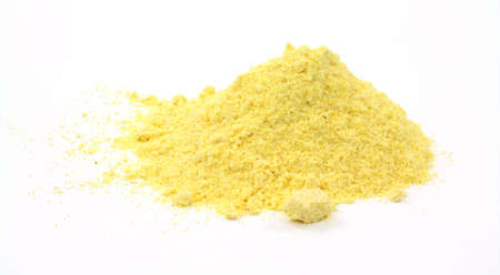 corn meal: Stone ground yellow corn meal on a white background.