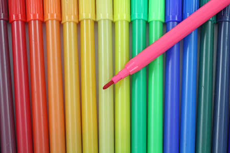Close view of a group of colorful markers with one opened on top. Stock Photo - 9151615