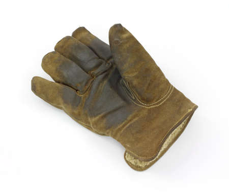 A single worn leather work glove on a white background.