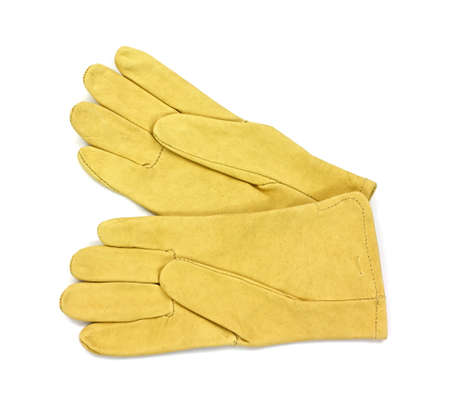A pair of womans leather gardening gloves on a white background. Фото со стока