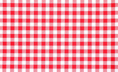 A very close view of a red and white checkerboard tablecloth. 스톡 콘텐츠