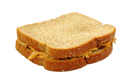 A freshly made peanut butter sandwich with wheat bread on a white background. photo