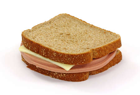 A wheat bread cheese and bologna sandwich on a white background. Stock Photo