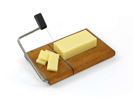 A bar of reduced fat sharp cheddar cheese that has been sliced on a wood wire cutting board.