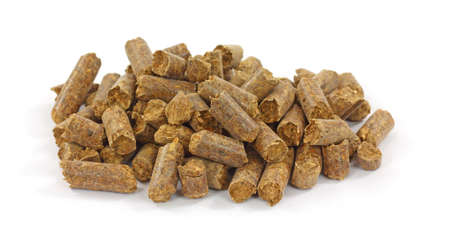 A small pile of smoke flavoring pellets for barbecue on a white background. Standard-Bild