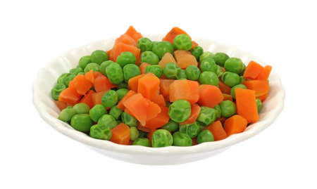 A small serving of peas and carrots in a white dish.