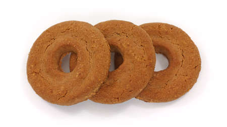 Three chocolate shortbread cookies on a white background. Stock Photo - 9615825