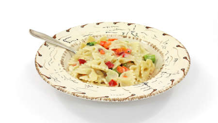primavera: A single serving of pasta Primavera in a southwestern style bowl with fork on a white background.  Stock Photo