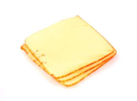 A small pile of several slices of muenster cheese.