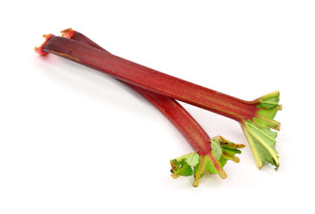 rhubarb: Two stalks of rhubarb with the greens cut on a white background.