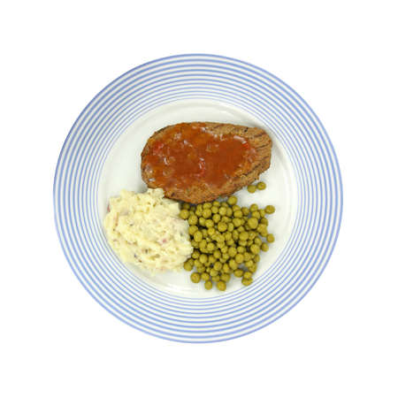 Slice of meatloaf on a blue plate with peas and potatoes on a white background. photo