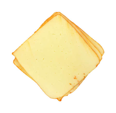 sliced cheese: Several slices of muenster cheese on a white background.