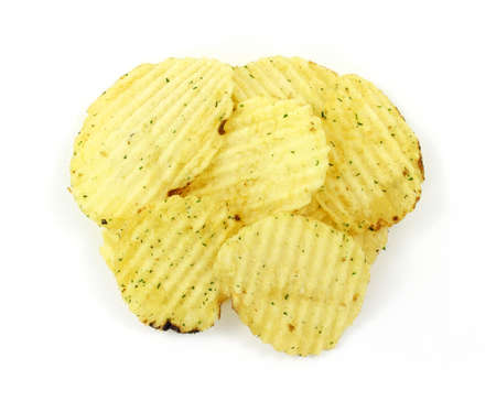 ridged: A small group of ridged sour cream and onion potato chips on a white background. Stock Photo