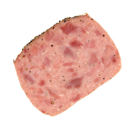A single slice of luncheon loaf deli meat with peppers on a white background.