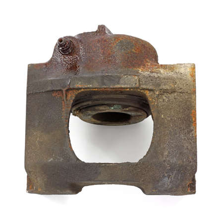 brake caliper: View of the back of an old worn out brake caliper. Stock Photo