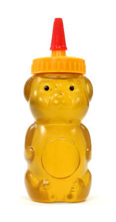 shaped: Honey in a molded plastic container shaped like a bear. Stock Photo