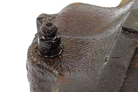 brake caliper: A close view of the brake bleeder valve that is frozen shut on a brake caliper.