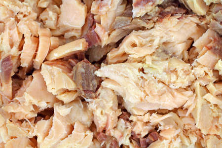 tinned: A very close view of chunks of pink salmon.