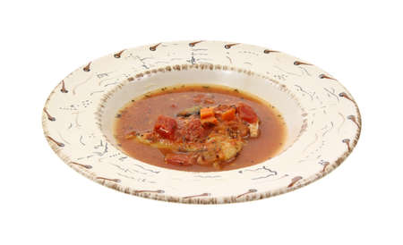 Small serving of chicken cacciatore in a southwestern style bowl on a white background.  Stock Photo - 10331149