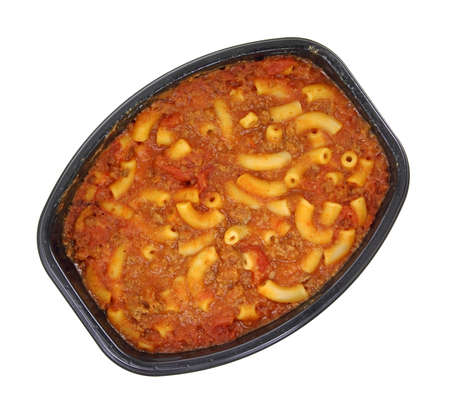 A freshly microwaved meal of macaroni and beef in tomato sauce on a white background.