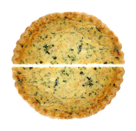 Two halves of spinach quiche pies on a white background. photo