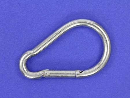 shackle: A heavy duty metal shackle on a blue background.