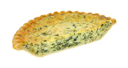 Half of a freshly baked spinach quiche pie on a white background.  photo