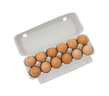 A dozen brown shelled eggs in a gray cardboard container on a white background. Stock Photo - 10594750