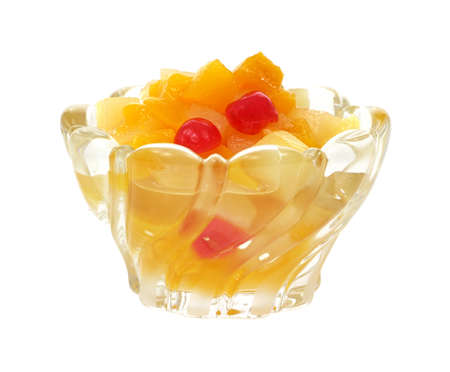 Glass dish filled with fruit cocktail on a white background.